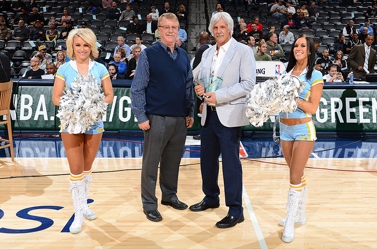 Nuggets athletic trainer Jim Gillen acknowledges the crowd during a pregame ceremony in his honor.