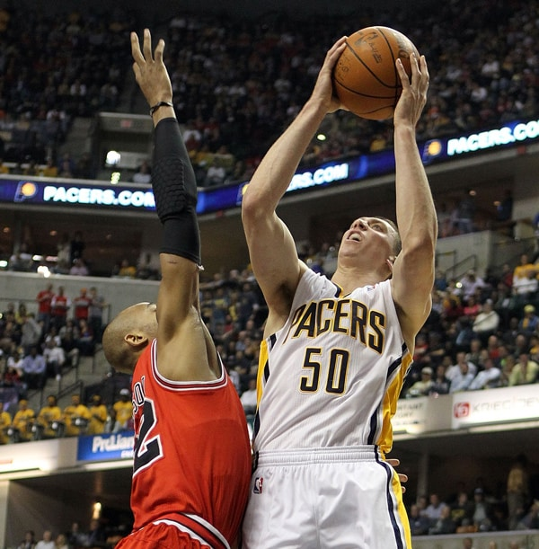 4506f71c7034 Tyler Hansbrough  50 of the Indiana Pacers shoots the ball while defended  by Taj Gibson