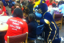 Boomer stops by the United Way event at IPS#44.