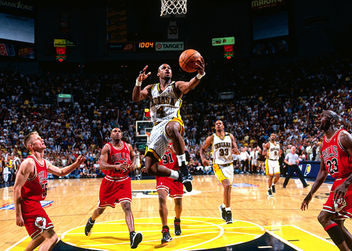 e8a015a1daa Travis Best  4 of the Indiana Pacers drives to the basket for a layup  against
