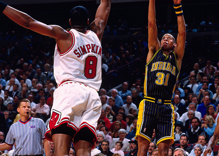 08faabd8a59 Reggie Miller  31 of the Indiana Pacers shoots a jump shot against Dickey  Simpkins
