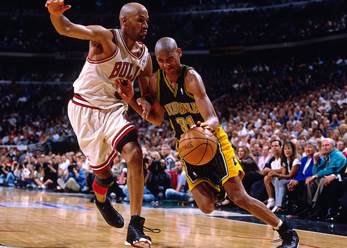 ce242b26ac8 Reggie Miller  31 of the Indiana Pacers drives to the basket against Ron  Harper