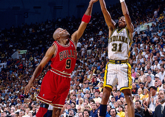 af6aa390051 Reggie Miller  31 of the Indiana Pacers shoots a jump shot over Ron Harper