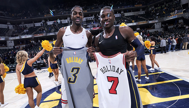 Justin Holiday's Career in Photos