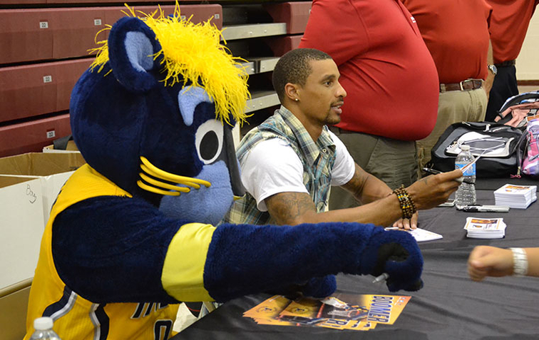 Boomer and George Hill hand out autographs