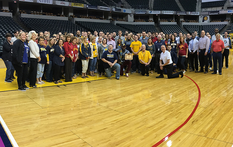 Paul George with PS&E employees