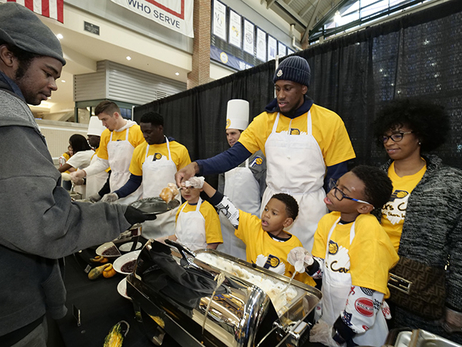 "Thaddeus Young and family at the 2018 ""Come to Our House"" Thanksgiving Dinner"