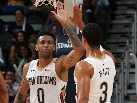 Pelicans guards Nickeil Alexander-Walker and Josh Hart high-five