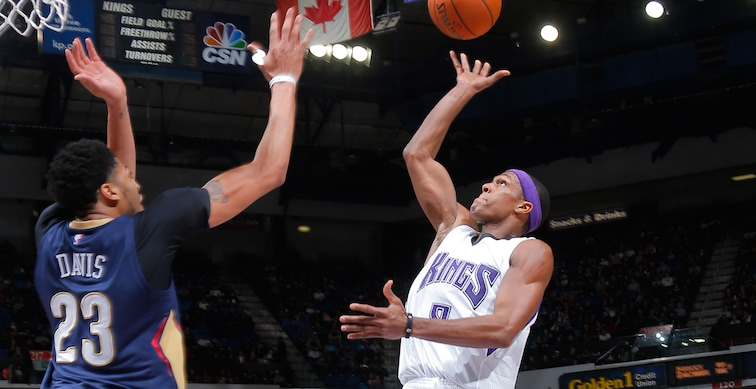 While with Sacramento in 2015-16, Rajon Rondo lofts a floater over New Orleans forward Anthony Davis