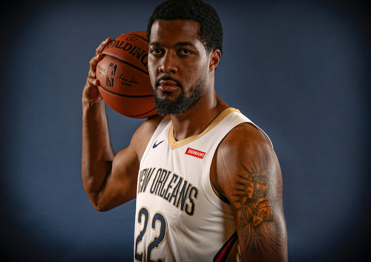 Derrick Favors on Media Day, displaying his unique tattoo