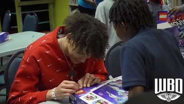 Hayes delivers LEGOS to children