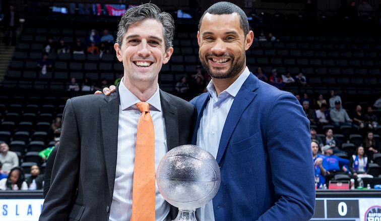 Trajan Langdon (right) picks up the trophy for G League Executive of the Year
