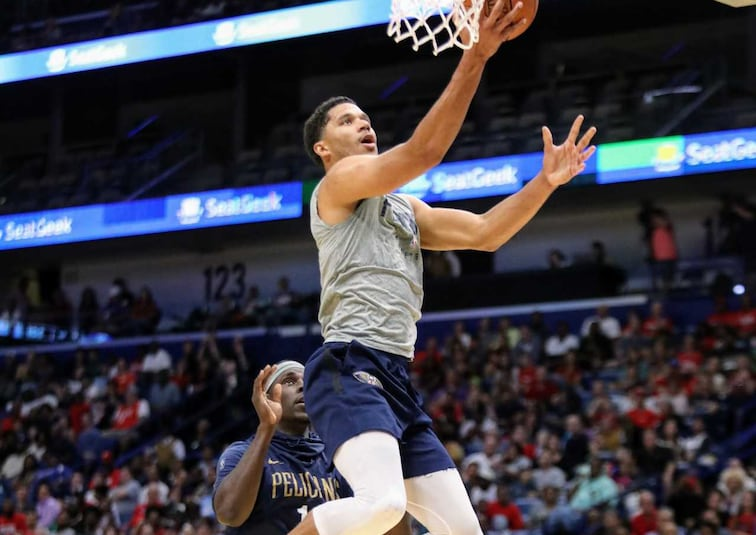 Josh Hart glides in for a layup at open practice