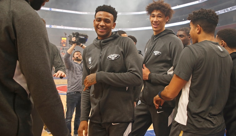 Nickeil Alexander-Walker (left) and Jaxson Hayes smile during pregame introductions