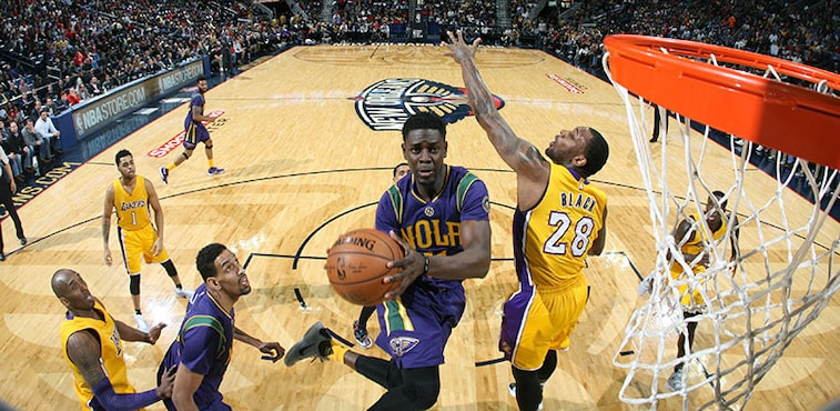 Jrue Holiday takes it to the basket against the Lakers in February