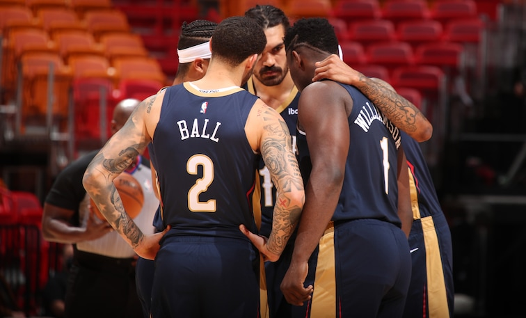 Pelicans starters huddle before Monday's win at Miami