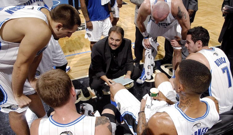 Stan Van Gundy huddles with players in Orlando