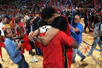 The New Orleans Pelicans celebrate their victory and first playoff birth.