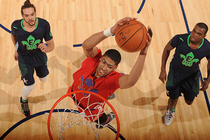 Anthony Davis soars for a two-hand slam during the 2014 All-Star Game in New Orleans