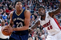 Anthony Davis takes the ball to the basket against Miami defender Udonis Haslem