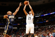 Anthony Davis lofts a deep two-point jumper over Indiana forward David West