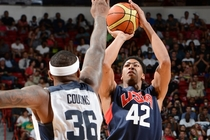 Anthony Davis fires a shot over DeMarcus Cousins during Friday's USA showcase game in Las Vegas