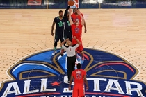 Carmelo Anthony and Blake Griffin vie for the jump ball at the 2014 NBA All-Star Game