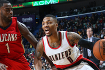 Damian Lillard drives against New Orleans defender Tyreke Evans