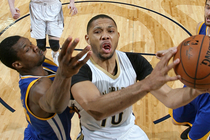 Eric Gordon shoots between Golden State defenders Harrison Barnes and Andrew Bogut