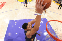 Anthony Davis skies for a two-hand dunk at the Lakers