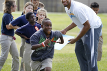 Xavier Henry runs drills with students at a Bee-Fit Field Day