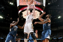Omer Asik takes a shot at the rim between Minnesota defenders Andrew Wiggins (left) and Nikola Pekovic
