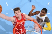 Omer Asik lays up a shot at Denver last season