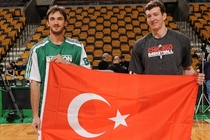 Past Turkey national team member Semih Erden (left) joins Omer Asik in holding their country's flag