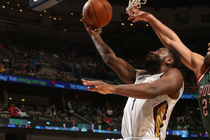 Tyreke Evans drives for a layup over Milwaukee's Zaza Pachulia
