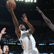 Tyreke Evans drives for a layup between the Miami defense
