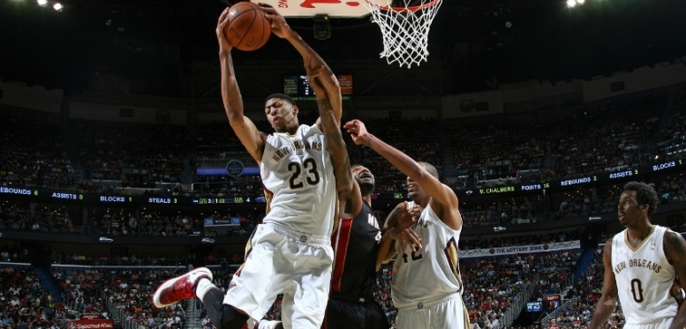 Anthony Davis clutches a rebound during a home victory over Miami