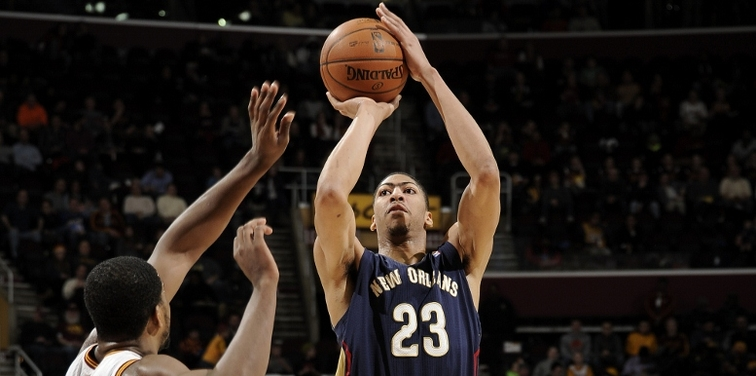 Anthony Davis launches a jumper over Cleveland forward Tristan Thompson
