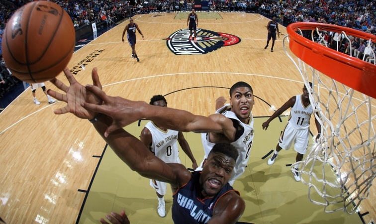 Pelicans forward Anthony Davis contests a shot by Charlotte forward Jeff Adrien