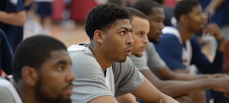 Anthony Davis watches workouts in Las Vegas last year with several well-known USA teammates