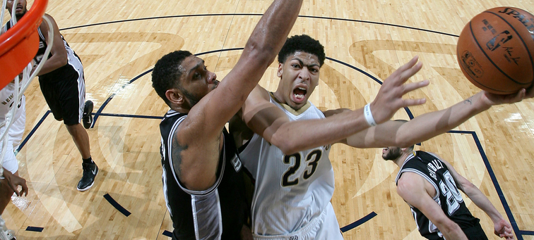 Anthony Davis takes a left-handed shot over San Antonio's Tim Duncan