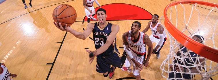 Anthony Davis leans in for a close-range shot at Portland in April