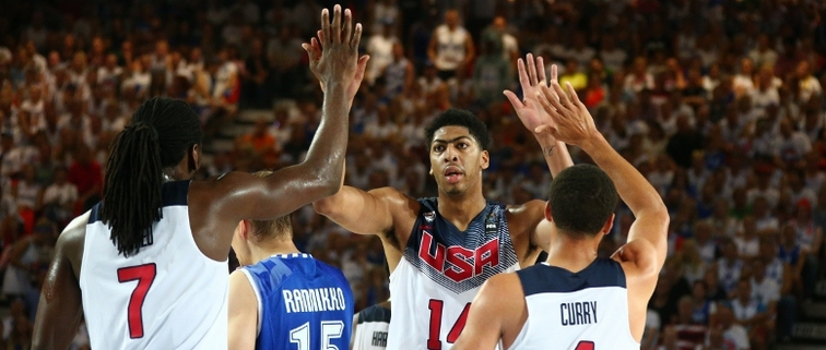 USA members Kenneth Faried and Stephen Curry congratulate Anthony Davis