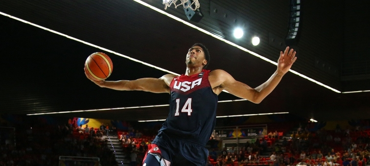 Anthony Davis soars for a one-handed fast-break dunk against Ukraine