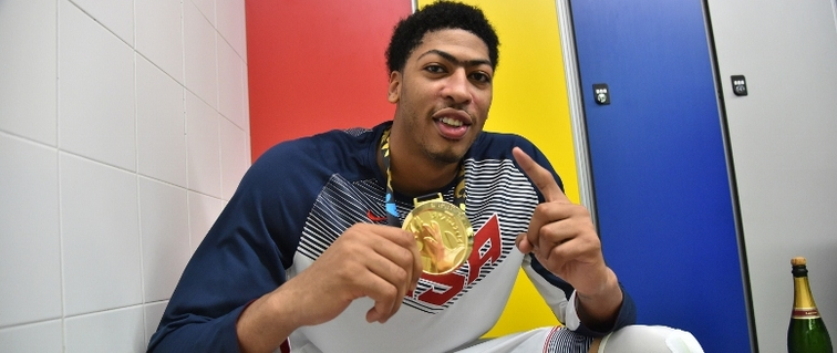 Anthony Davis displays his new gold medal from the FIBA World Cup