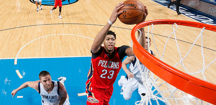 Anthony Davis dunks on a fast break at Dallas