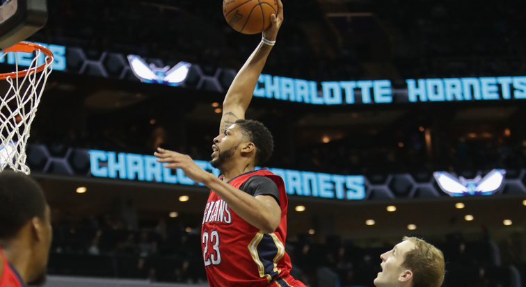 Anthony Davis soars for a dunk at Charlotte
