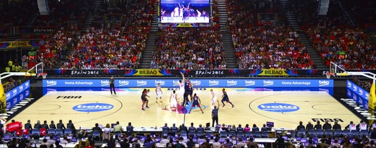 Turkey's Omer Asik (in white) and USA's Anthony Davis vie for the jump ball in an Aug. 31 game