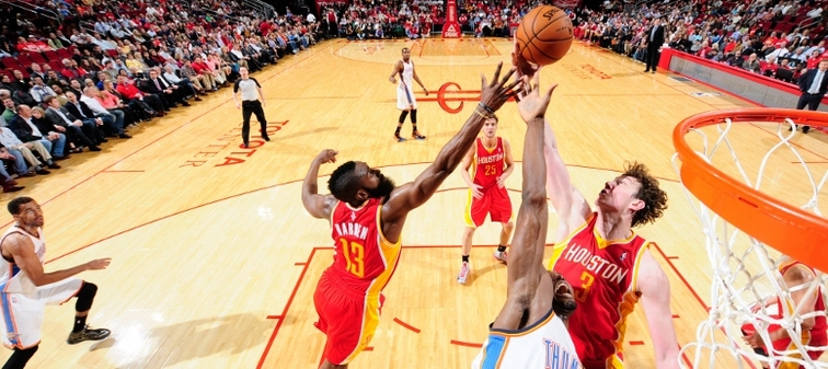 James Harden and Omer Asik vie for a rebound with Oklahoma City's Serge Ibaka