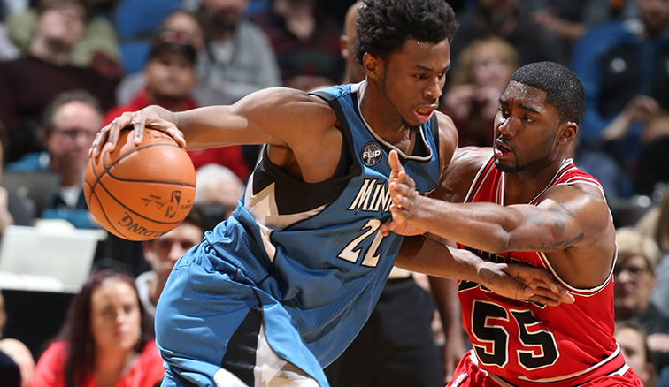 E'Twaun Moore (55) plays physical defense against Minnesota wing Andrew Wiggins